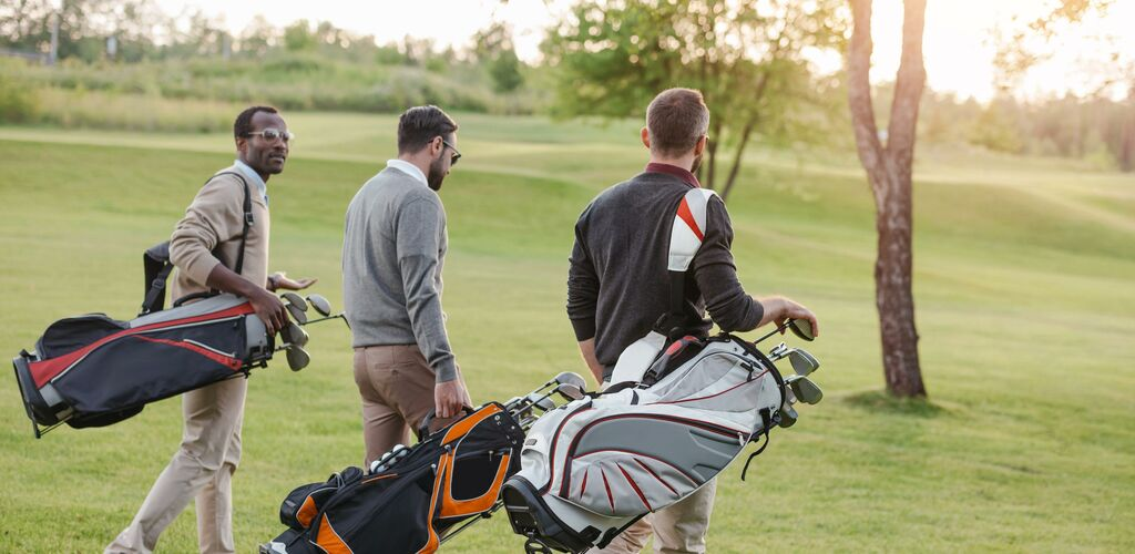 People carrying golf bags